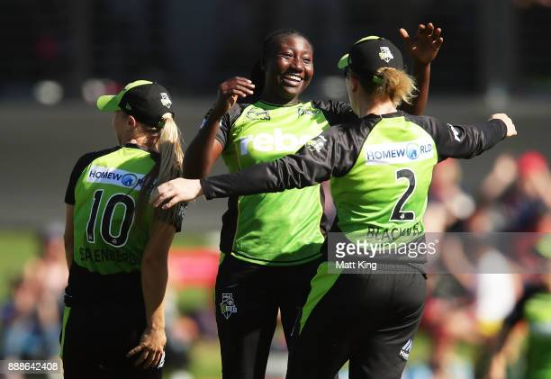 Stafanie Taylor of the Thunder celebrates victory with Naomi Stalenberg and Alex Blackwell during the Women's Big Bash League WBBL match between the...