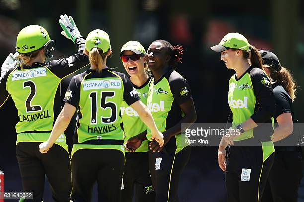 Stafanie Taylor of the Thunder celebrates with team mates after taking the wicket of Ellyse Perry of the Sixers during the Women's Big Bash League...