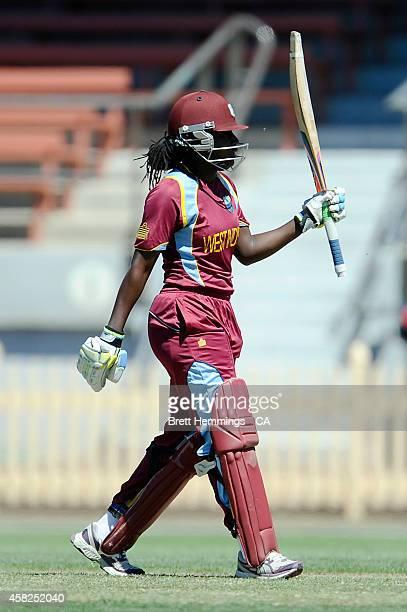 Stafanie Taylor of West Indies celebrates scoring a half century during the women's International Twenty20 match between Australia and the West...
