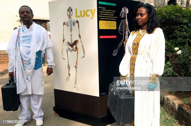 Staff accompany the Lucy the Australopithecus, which is a collection of fossilised bones that once made up the skeleton of a hominid from the...