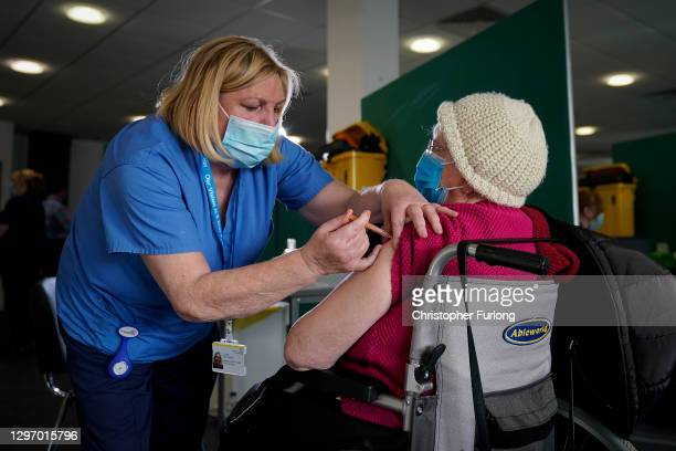 Staff administer the Oxford-AstraZeneca Covid-19 coronavirus vaccine at Totally Wicked Stadium, home of St Helen's rugby club, one of the new mass...