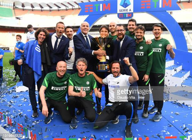 """Staff and Antonio Conte of FC Internazionale poses with the trophy for the victory of """"scudetto"""" at the end of the last Serie A match between FC..."""