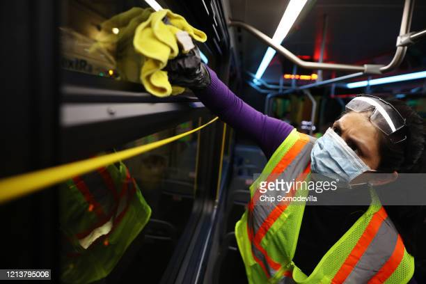 Staff and contractors work through the night to clean and disinfect public buses at the Montgomery County Division of Fleet Management Equipment...