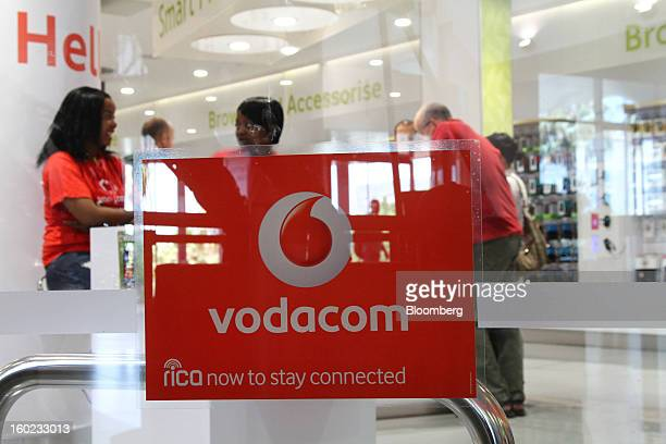 Staff and customers are seen inside a Vodacom store at Vodaworld the headquarters of Vodacom Group Ltd Vodafone's biggest African business in...