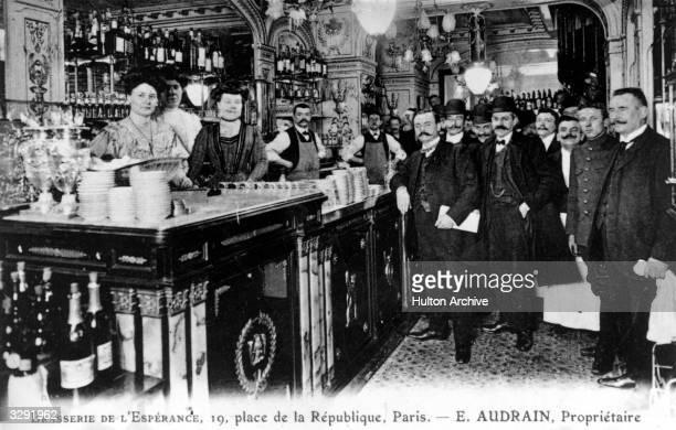 Staff and customers of the Brasserie de L'Esperance in the Place de la Republique in Paris