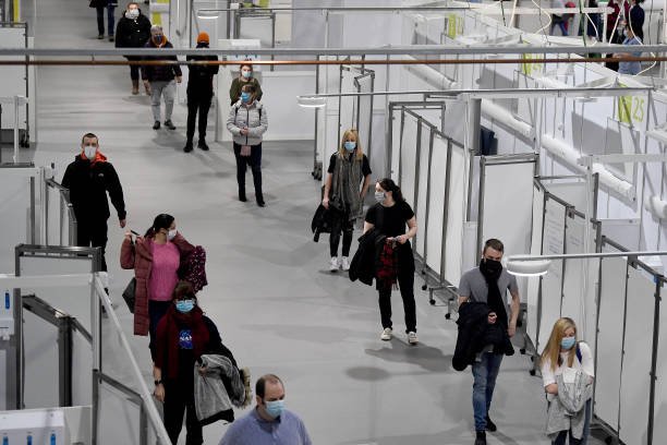 GBR: People Queue To Receive Covid Vaccines At The Louisa Jordan Hospital