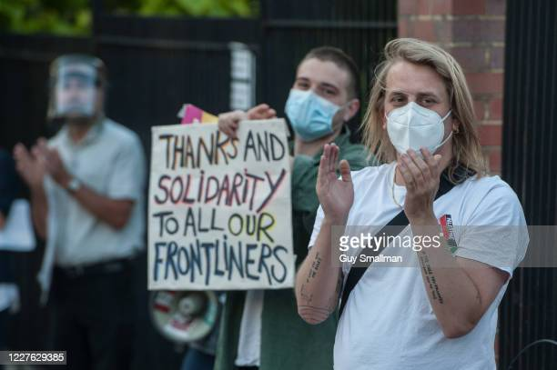 Staff and members of the public applaud key workers on May 28, 2020 in London, United Kingdom. For 10 weeks, the public have applauded NHS staff and...