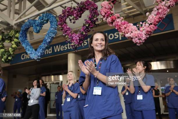 NHS staff and members of the public take part in the weekly Clap for Our Carers event at Chelsea Westminster Hospital on May 28 2020 in London United...