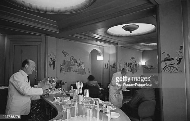 Staff and patrons at a bar in the Ritz Hotel London 1950