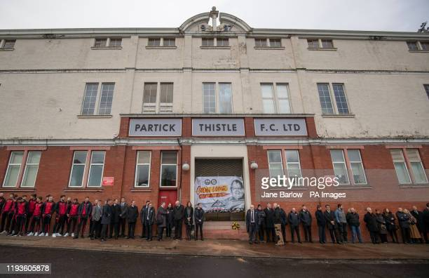 Staff and players wait for the funeral cortege of Euromillions winner Colin Weir to pass Partick Thistle's Firhill Stadium on its way to the funeral...