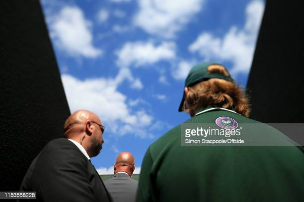 Staff and security stand by on Day 3 of The Championships - Wimbledon 2019 at the All England Lawn Tennis and Croquet Club on July 3, 2019 in London,...