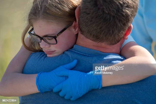 Staff and students comfort each other outside Noblesville West Middle School after a shooting at the school on May 25 2018 in Noblesville Indiana One...