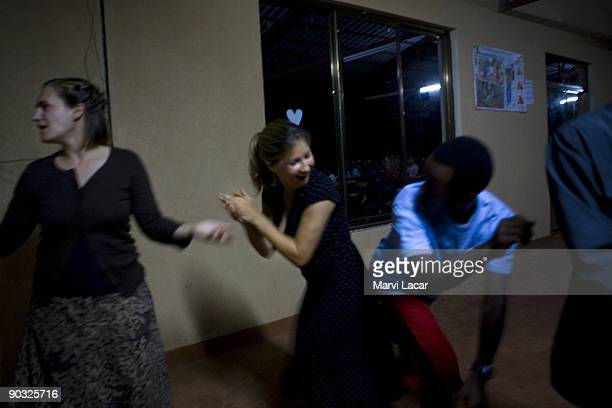 Staff and students mingle after Friday night dinner inside the Agahozo Shalom Youth Village on March 13 2009 in Rwamagana Rwanda The ASYV provides...