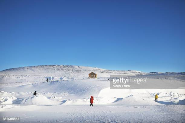 NASA staff and visitors explore ice near Thule Air Base on March 25 2017 in Pituffik Greenland NASA's Operation IceBridge is flying research missions...