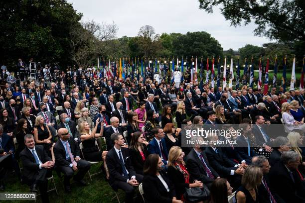Staff and visitors listen as President Donald J. Trump speaks with Judge Amy Coney Barrett during a ceremony to announce Barrett as his nominee to...