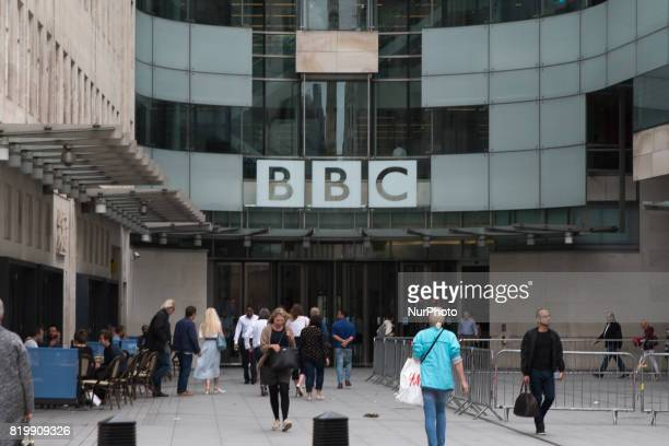 Staff and visitors walk outside the British Broadcasting Corporation headquarters London on July 20 2017 British public broadcaster BBC came under...