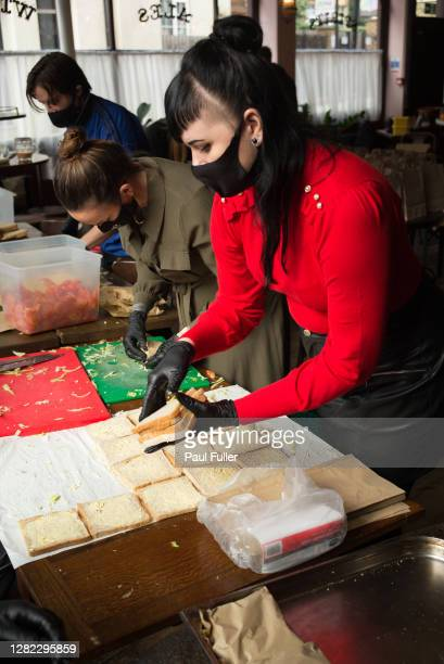 Staff and volunteers at the The Plough pub in Homerton prepare sandwiches as part of the effort to provide free school meals to those in need on...