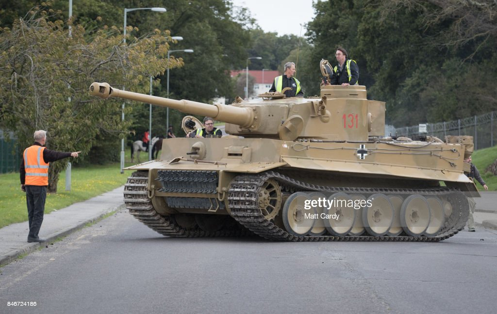 Staff and volunteers help move a German Tiger Tank, the only working example in the world, at the Bovington Tank Museum ahead of this weekend's Tiger Day when the WW2 tank, Tiger 131, will be demonstrated to the public, on September 13, 2017 in Dorset, England. Bovington The Tank Museum is home to Tiger 131, which was captured intact by the allies during fierce fighting in the Tunisian desert in 1943 and is currently part of a world-first exhibition, The Tiger Collection, which showcases the entire Tiger family side-by-side. Such was the importance of its capture that Prime Minister Winston Churchill and King George VI went to North Africa be pictured with it.