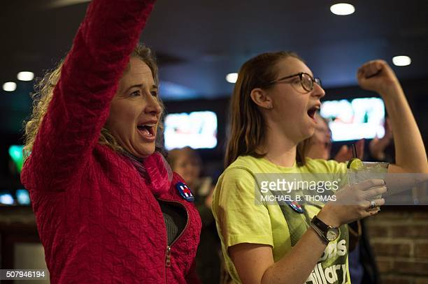 Staff and volunteers of the Hillary Clinton Burlington Iowa campaign field office cheer as Hillary Clinton speaks on the television at the Boogaloo...