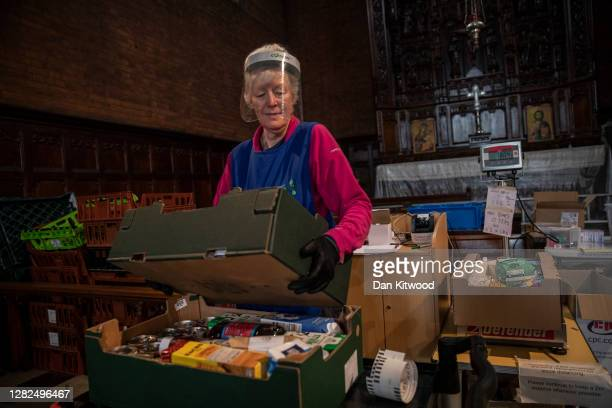 Staff and volunteers pack and prepare food parcels at the South London warehouse and distribution centre at St Margaret's Church on October 27, 2020...