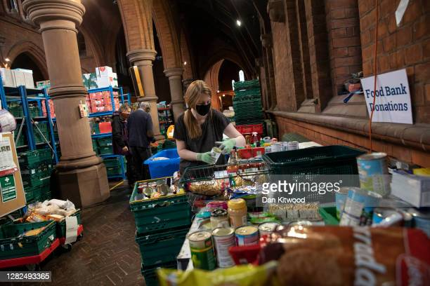 Staff and volunteers pack food parcels at the Norwood and Brixton food bank distribution centre at St Margaret's Church on October 27, 2020 in...
