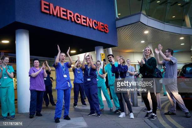 NHS staff applaud themselves and their colleagues at the entrance of the Royal Liverpool Hospital as part of the Clap For Our Carers campaign on...