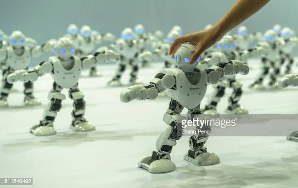 Staff are arranging the robots which will dance for audience On Jul 8th Beijing International Consumer electronics Expo was held in Beijing China...