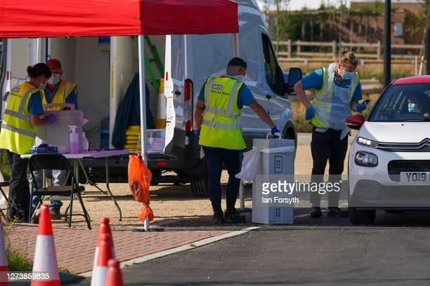 Staff at a NHS appointment only testing facility take testing kits from members of the public at a temporary testing facility at Kirkleatham on...