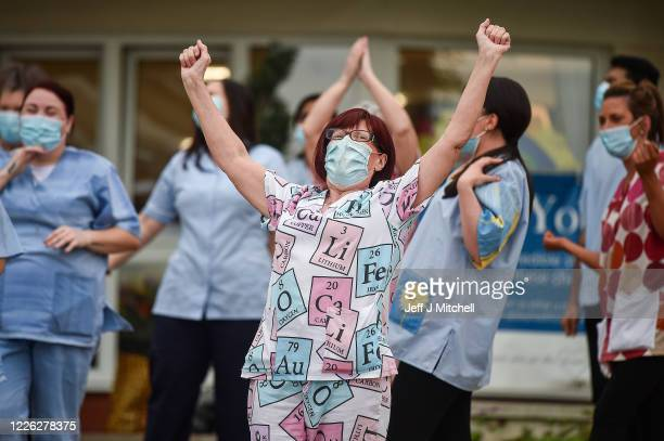 Staff at Abbeydale Court Care Home take part in Clap for Carers and key workers during ninth week of lockdown on May 21 2020 in Hamilton United...