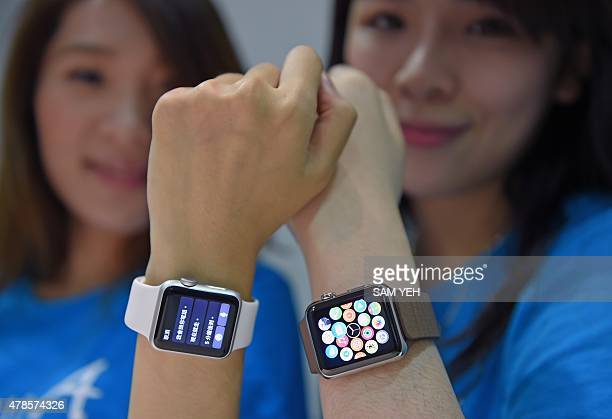 Staff at an Apple retail store display the company's new Apple Watch as the smartwatch goes on sale for the first time in Taipei on June 26 2015 The...