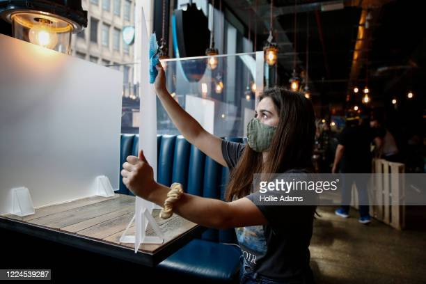 Staff at BrewDog Tower Hill prepare to reopen tomorrow with social distancing measures in place on Friday July 3, 2020 in London, England. After...