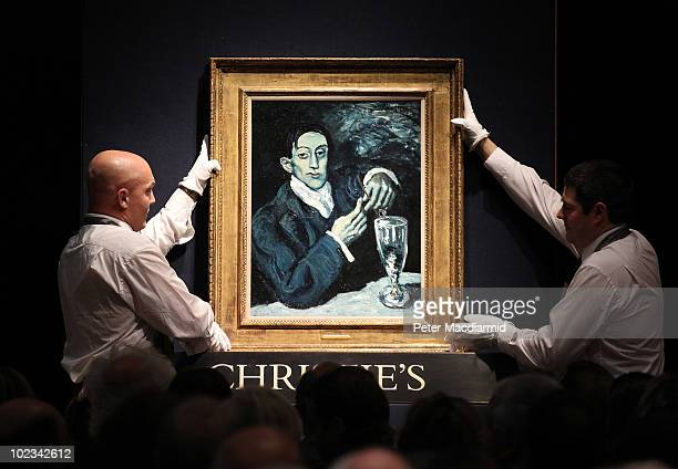 Staff at Christie's auctioneers display Pablo Picasso's 'Portrait d'Angel Fernández de Soto' on June 23 2010 in London England This work was sold for...