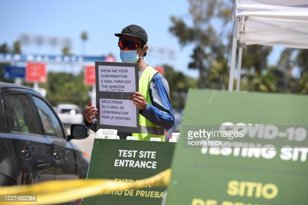 Staff at direct cars at a drive-through COVID-19 test site, July 15, 2020 at Dodgers Stadium in Los Angeles, California. - Los Angeles County Public...
