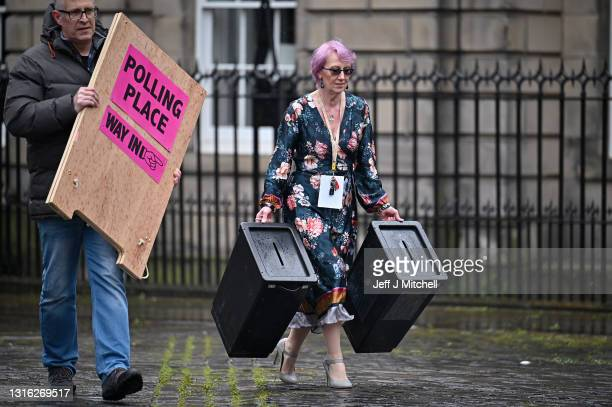 Staff at Edinburgh City Council move ballot boxes as they're taken for distribution to polling stations on May 4, 2021 in Edinburgh, Scotland....