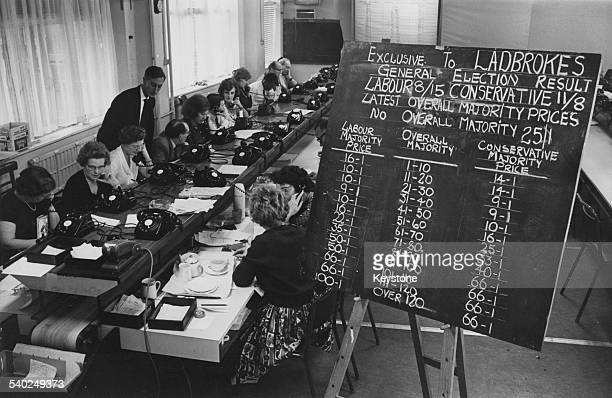 Staff at London bookmakers Ladbrokes busy taking bets for the upcoming General Election, 6th October 1964.