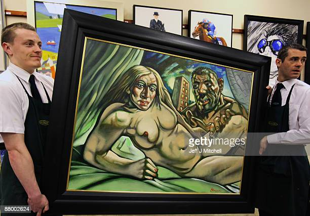 Staff at McTeers auctioneers move the Peter Howson controversial Madonna and Guy on May 27 2009 in Glasgow Scotland The painting of the pop icon and...