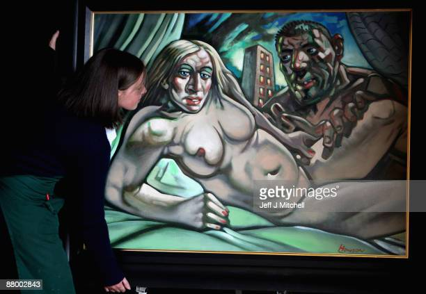Staff at McTeers auctioneers move the Peter Howson controversial Madonna and Guy painting on May 27 2009 in Glasgow Scotland The painting of the pop...