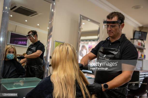 Staff at Q Studio hair salon practice using PPE ahead of reopening their premises to the public for the first time since the start of pandemic on...