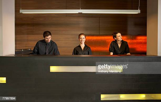Staff at reception in hotel lobby