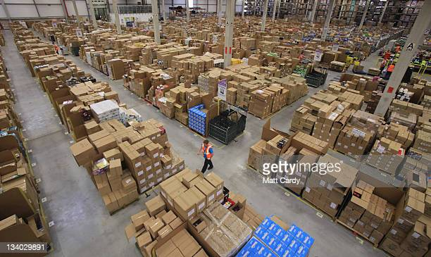 Staff at the Amazon Swansea fulfilment centre process orders as they prepare their busiest time of the year on November 24 2011 in Swansea Wales The...