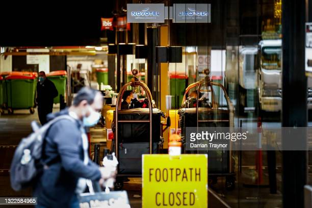 Staff at the Novotel Ibis Hotel in Melbourne are seen wearing face masks on June 09, 2021 in Melbourne, Australia. Speculation the dangerous Delta...