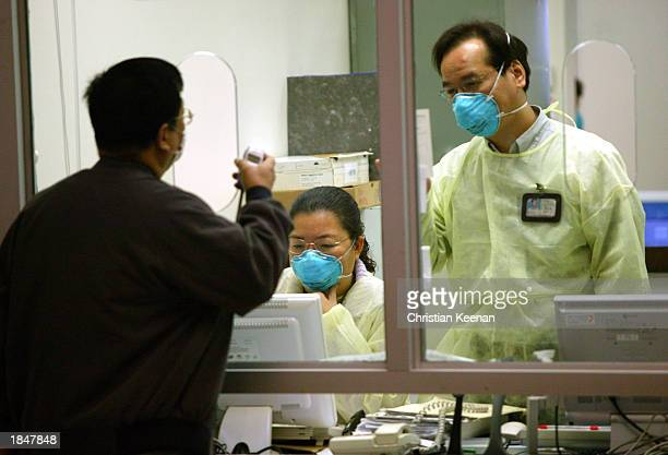 Staff at the Prince of Wales hospital wear face masks in an effort to protect themselves from a deadly and contagious respiratory virus March 14,...