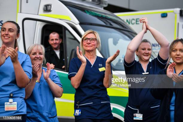 Staff at the Queen Elizabeth Hospital participate in the Clap for Carers and key workers after month of lockdown on April 23 in Glasgow, United...