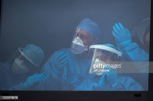 NHS staff at the Queen Elizabeth Hospital participate in the Clap for Carers and key workers during week six of lockdown on April 30 2020 in Glasgow...