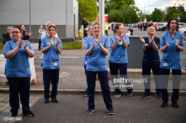 NHS staff at the Queen Elizabeth Hospital participate in the Clap for Carers and key workers during week eight of lockdown on May 14 2020 in Glasgow...