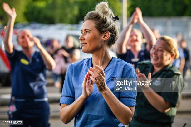 Staff at the Queen Elizabeth Hospital participate in what is expected to be the final Clap for Carers and key workers during week ten of lockdown on...