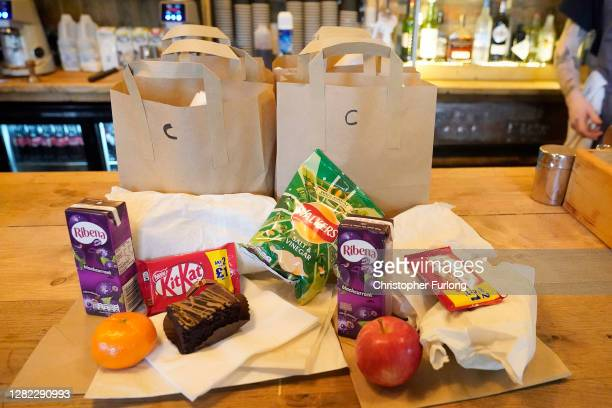 Staff at The Watering Can Restaurant and Cafe in Liverpool's Greenbank Park prepare free half-term meal packs for children on October 26, 2020 in...