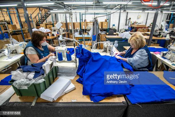 Staff at Tibard begin work on a new order of 20000 nurses uniforms at their factory in Dukinfield where they usually make catering uniforms for the...