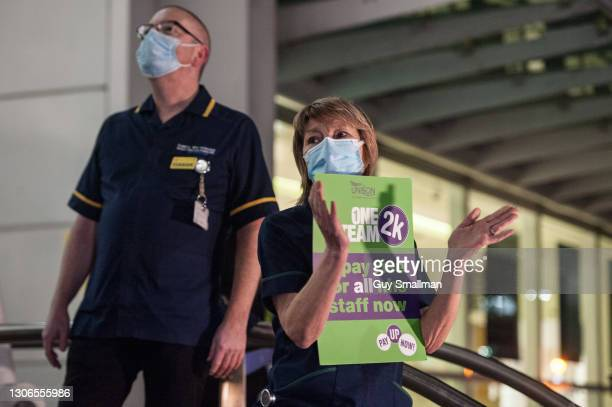 Staff at University College Hospital in North London protest over the government pat offer with a slow hand clap on March 11, 2021 in London, United...