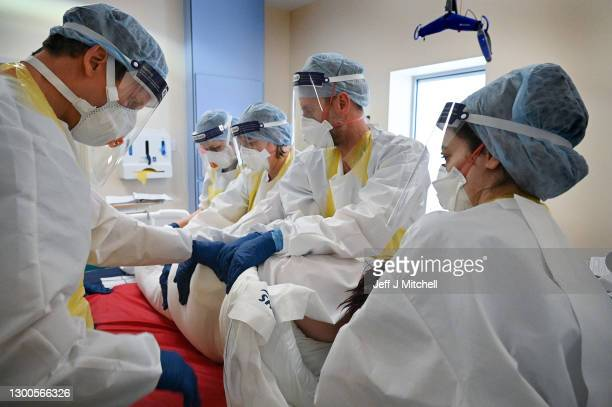 Staff at University Hospital Monklands attempt to prone a Covid-positive patient on the ICU ward on February 5, 2021 in Airdrie, Scotland. Proning is...